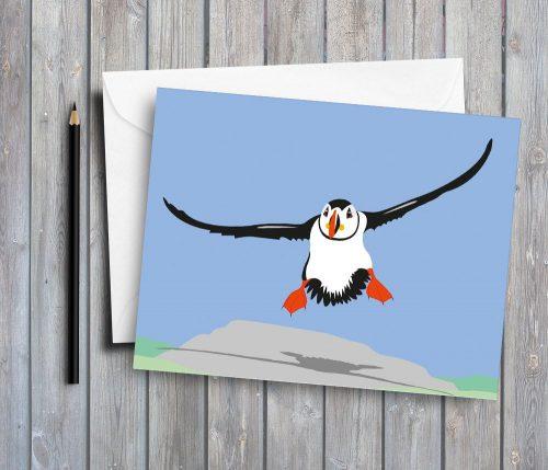 flying puffin greeting card by Deborah Dey